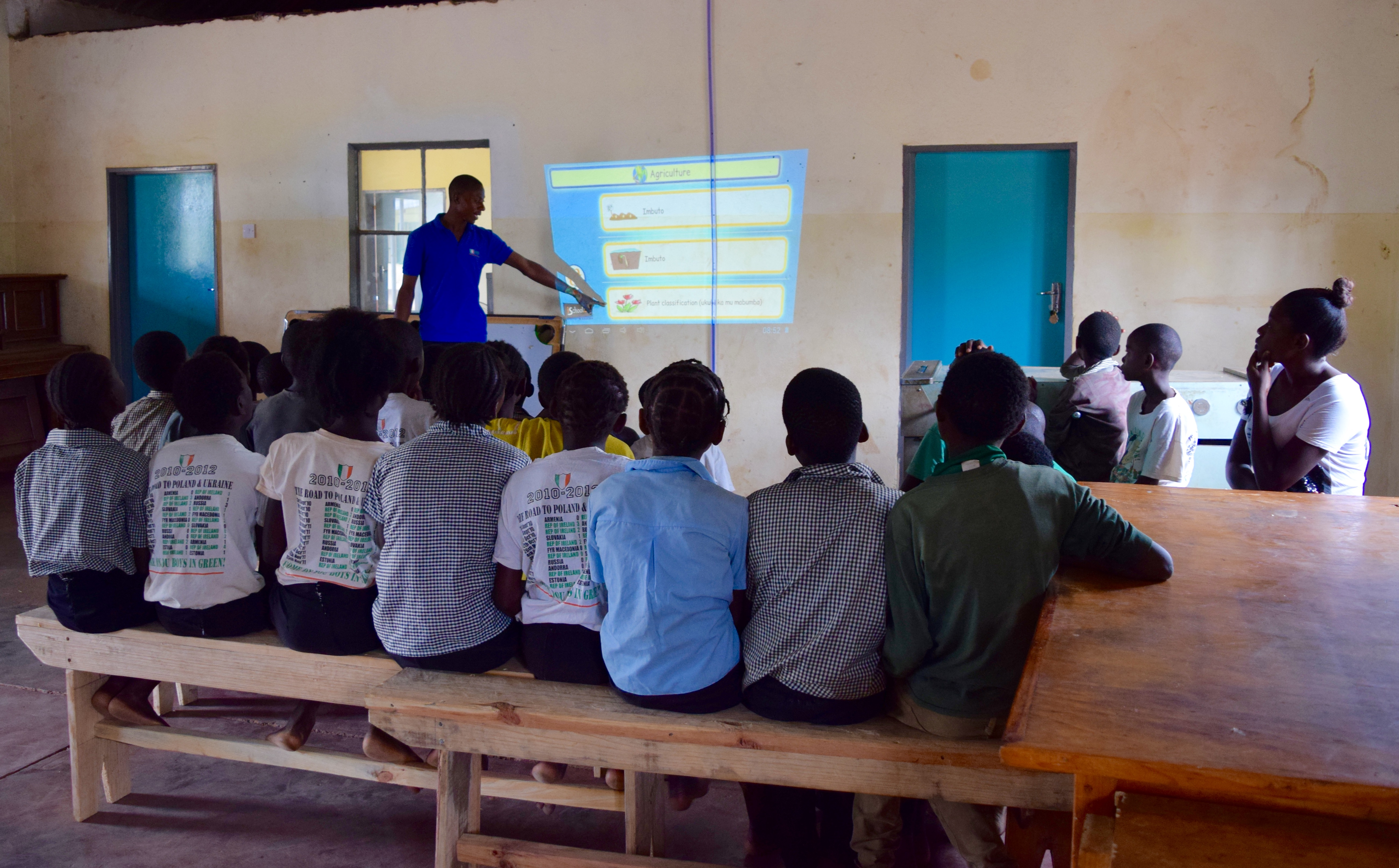 Teacher using projector in the class room